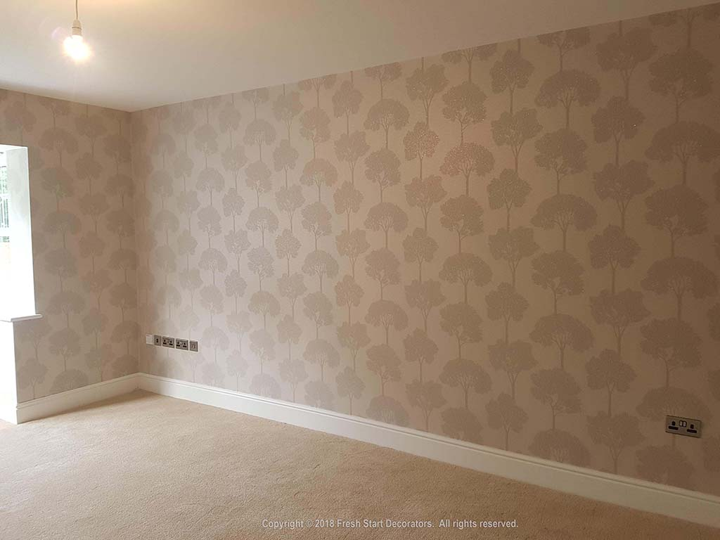 Domestic home interior wallpapering by decorators